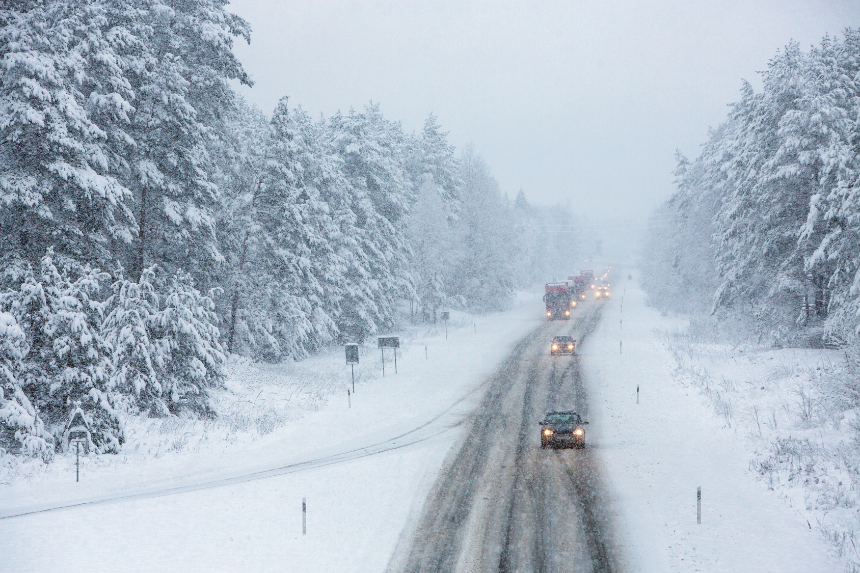 Several cars on a winter road